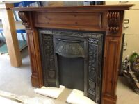 A full reclaimed fireplace package including Surround ,Cast insertand Black Granite hearth