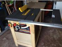 10inch table saw new blade set in a cabinet