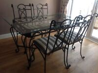 Glass dining table with 4 chairs & free matching coffee table