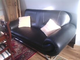 Black year old compact 3 seater sofa