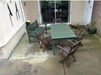 4 solid wooden chairs, table and bench