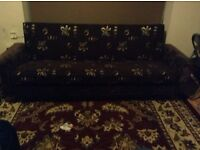 Settee in very good condition - Storage inside and turns into a bed