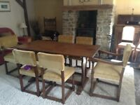 Oak dining table and six upholstered, very comfortable chairs. Excellent condition.