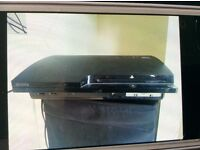 PS3 slim console 120gb and 25 games