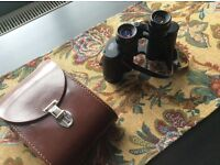 Carl Zeiss 8x30w binoculars includes leather case .perfect condition..