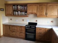 Solid oak kitchen - low and eye level units with appliances