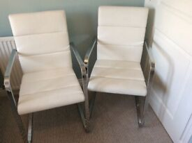 White Brinkmann leather dining chairs with chrome arms