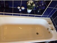 Free cream steel bath with taps as seen