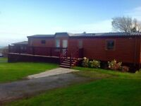 Beautiful 6 berth lodge with stunning sea views situated at Haven Hafan Y Mor holiday park, Wales.