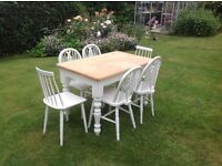 Pine top dining table and 6 chairs.