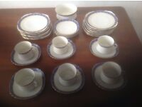 6 cups and saucers, with 4 spare saucers.