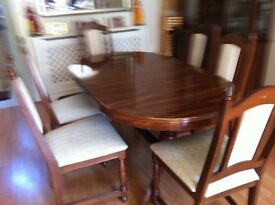 Walnut finish oval extending table and 6 chairs . REDUCED
