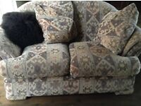 Matching 2 and 3 seater sofas armchair and footstool in patterned fabric