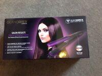 Purple 'Glamoriser' hair straightener, like new with box. Under warranty with receipt.