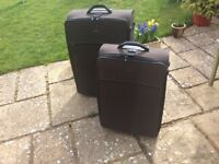 A pair of 'His and Hers' suitcases. 'HEAD' Brand. Good clean condition