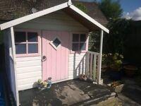 Wooden outdoor playhouse