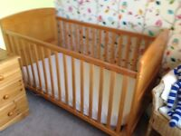 Pine cot bed with mattress, used for grandchild visits