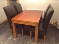 Medium-size Dining table and 4 Leather chairs for sale. - VGC