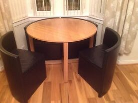 Large round dining table with four chairs