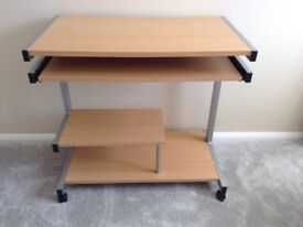 Desk with extendable keyboard shelf
