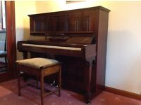 Traditional upright piano with stool