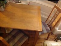 Dining room table with 4 chairs. Good condition, chairs recently recovered.