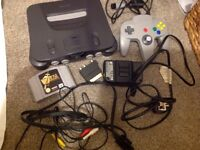 Nintendo 64 black all cables and controller with Zelda the ocarina of time and 4MB RAM expansion