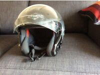 Two motorcycle helmets. Caberg and Nitro.