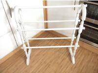 White free standing towel rail.