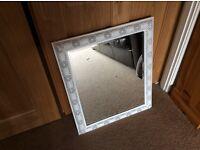 White metal framed mirror