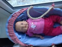 Reborn weighted baby doll with free clothes and carrycot