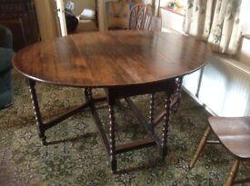 Antique Welsh Gate leg table, unusual bobble-legs, dark wood (probably Oak), in good condition.