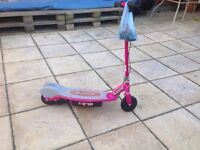Razor electric scooter for kids in pink with charger and stand.