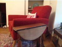 Folding round coffee table
