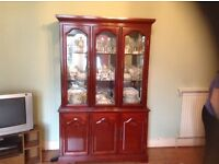 Display cabinet with glass shelves and mirror back.