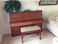 Steinmayer upright piano and piano stool.
