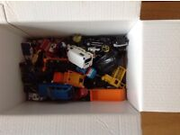 Box of toy cars,bikes and lorries
