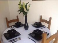 Black 24 pieces stone dinnerware. John Lewis black cutlery sets (2). Black John Rocha vase