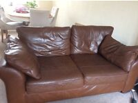 Two seater and three seater brown leather settee for sale four years old excellent