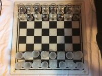 A Shot Glass Chess set. Excellent condition and in box