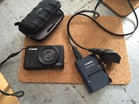 Cannon Powershot S100, with 4GB memory Card, case and charger.