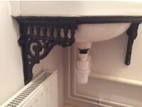 Cast iron corner sink brackets with sink and taps
