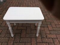 Small wooden side table painted white.Very good condition.H44cm x W57cm x L42cm