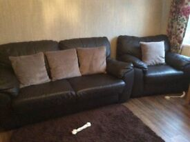 Brown leather sofabed and armchair