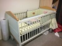 Cot bed includes mattress and bedding