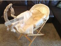 Moses basket ,complete with stand bedding and mobile.
