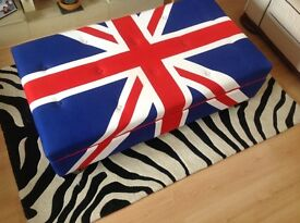 Storage. Union Jack Ottoman great for extra seating and storing CD/DVDs/Books.