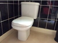 White bathroom WC and matching wash hand basis with mixer tap
