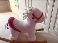 Pink and white fabric rocking horse