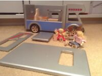 Wooden camper van and family